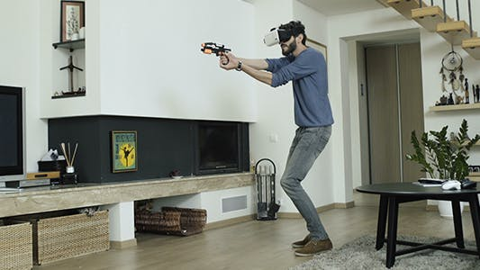Thumbnail for Man Playing Action Game In VR World