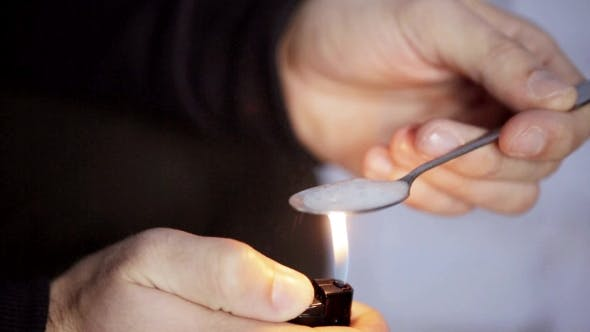 Thumbnail for Addict Preparing Dose Of Crack Cocaine Drug 34