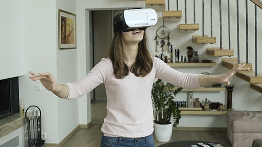 Thumbnail for Girl Explores Virtual Reality Device Interface