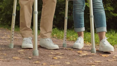 Female and Male Legs with Walker