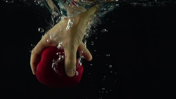 Thumbnail for Man Hand Reaches And Grabs Red Apple Floating Under Water Super  Shot