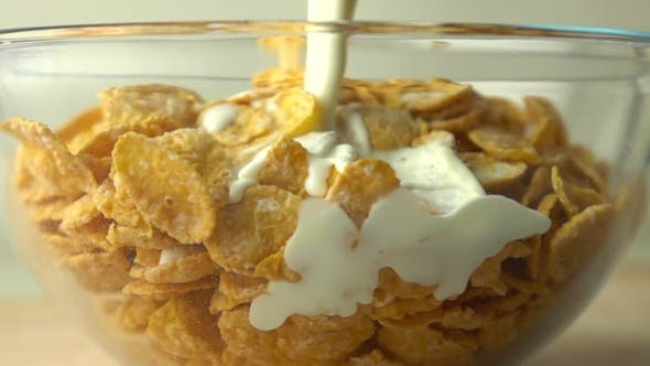 Thumbnail for Pouring Some Milk Over Golden Corn Flakes In Glass Bowl Super  Video