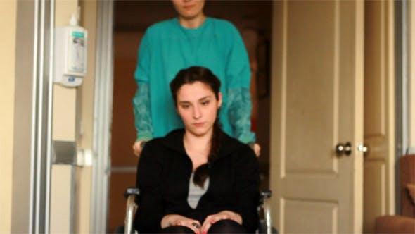 Thumbnail for Nurse Carrying Patient in a Wheelchair at Hospital