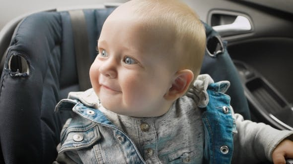 Thumbnail for Little Boy Sitting in a Special Car Seat