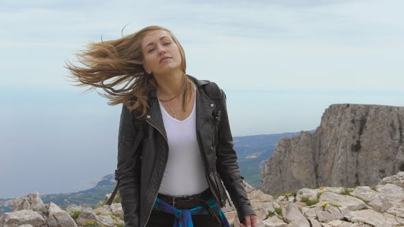 Thumbnail for Young Woman Standing On Cliff