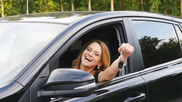 Thumbnail for Woman Driver Holding Car Keys Driving Her New Car