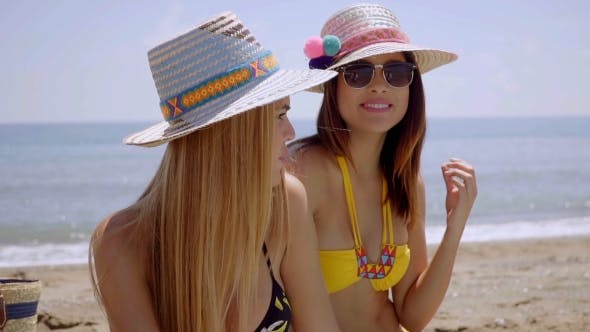 Thumbnail for Two Female Friends On a Beach In The Summer