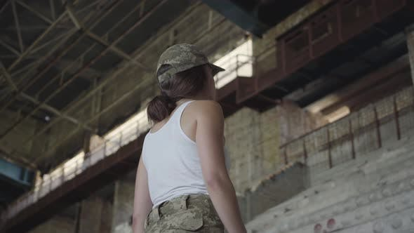 Thumbnail for A Young Woman in Military Uniform Training in an Abandoned Building