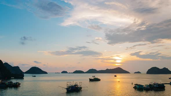 Thumbnail for Time lapse: Vietnam Cat Ba bay at sunset to night with floating fishing boats on sea