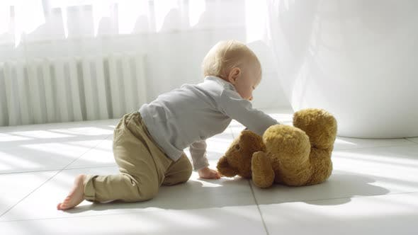 Adorable Baby Crawling Towards Toy