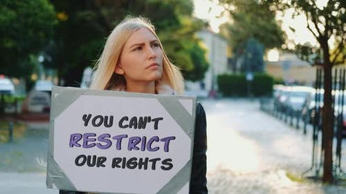 Blonde Woman Protesting Against Human Rights Restriction