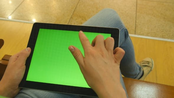 Thumbnail for Young Girl Sitting At Bench In Shopping Mall And Working With Tablet. Female Hands Using Tablet Pc