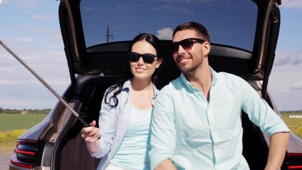 Thumbnail for Couple With Smartphone Selfie Stick At Car 12