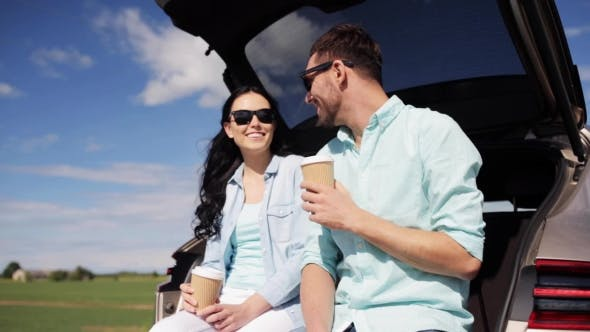 Thumbnail for Happy Couple With Coffee At Hatchback Car Trunk 29