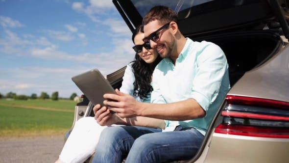 Thumbnail for Happy Couple With Tablet Pc At Hatchback Car 20