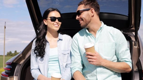 Cover Image for Happy Couple With Coffee At Hatchback Car Trunk 10