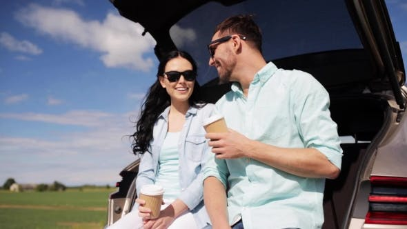 Thumbnail for Happy Couple With Coffee At Hatchback Car Trunk 27