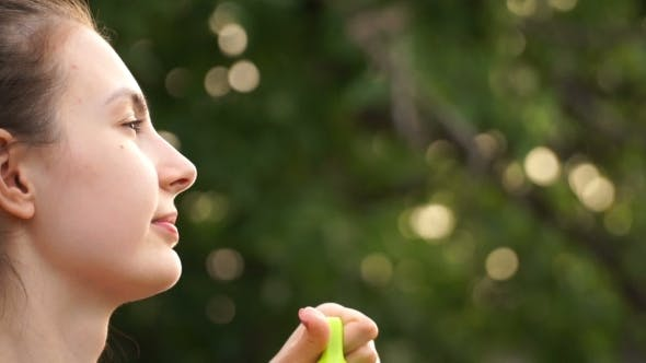Footage Woman Blowing Bubbles On Nature.