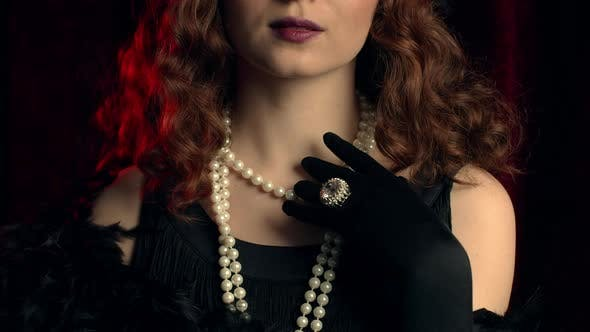 Woman Dressed in Style of Great Gatsby Demonstrates Jewelry and Bijouterie of That Time on Hands and