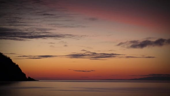 Thumbnail for Clouds Over a Lake At Sunrise, With Brilliant Colors.