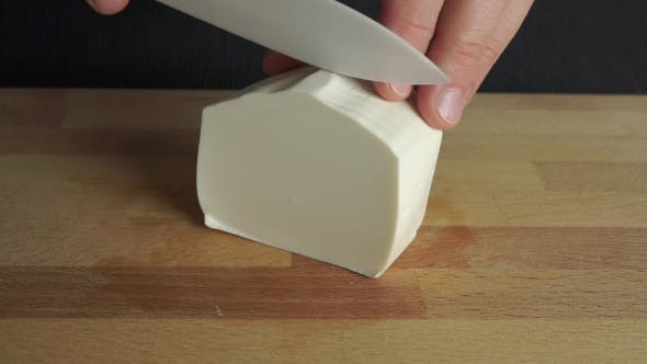 Cover Image for Man Cutting Off a Piece of White Soft Feta Cheese