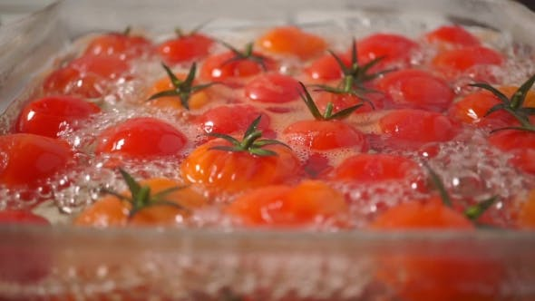 Thumbnail for Ripe Cherry Tomatoes Boiling In a Glass Pan