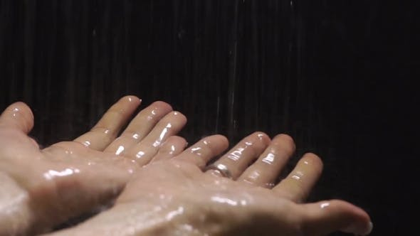 Thumbnail for Two Female Hands Under The Shower With Black Background