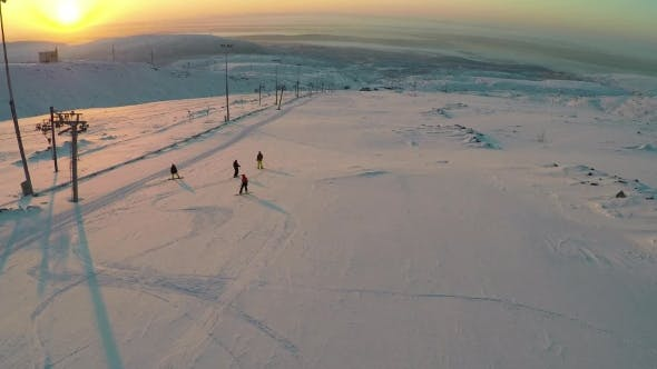 Thumbnail for Aerial View Of Skiers And Snowboarders At Sunset