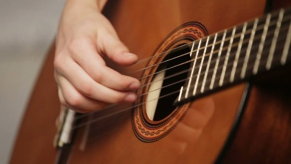 Thumbnail for Woman's Hands Playing Acoustic Guitar.