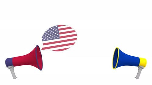 Speech Bubbles with Flags of the EU and the USA and Loudspeakers
