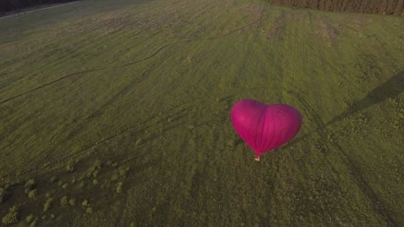 Thumbnail for Hot Air Balloon In The Sky Over a field.Aerial View