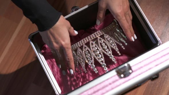 Thumbnail for Hands Locking a Briefcase With Diadem