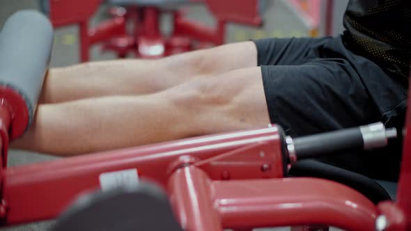 Thumbnail for Male Athlete Training Legs Muscles in Weights Trainer in Gym Club. Man Bodybuilder Training in