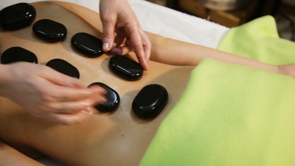 Thumbnail for Woman In Spa Salon With Hot Stones
