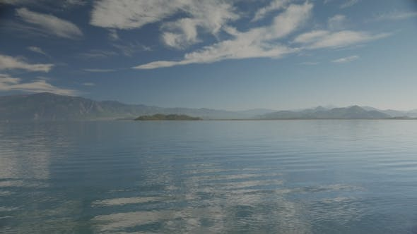 Thumbnail for The Lake View With Small Waves And Islands, Hills And Cloudy Sky On The Background.