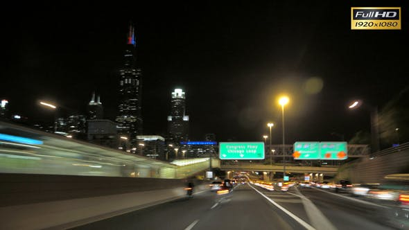 Driving at Full Speed to Downtown Chicago at Night