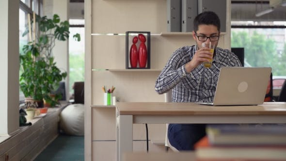 Cover Image for Man Working In Modern Contemporary Office.