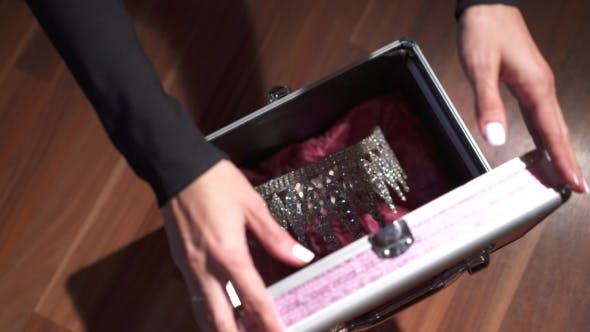Thumbnail for Female Hands Locking a Briefcase With Diadem