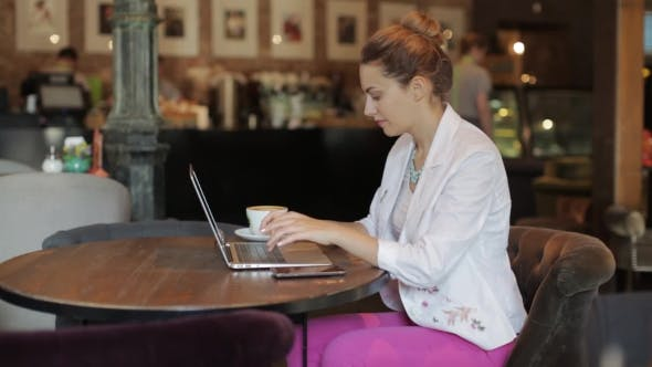 Thumbnail for Young Beautiful Business Lady Working On Laptop, Sitting In Cozy Cafe