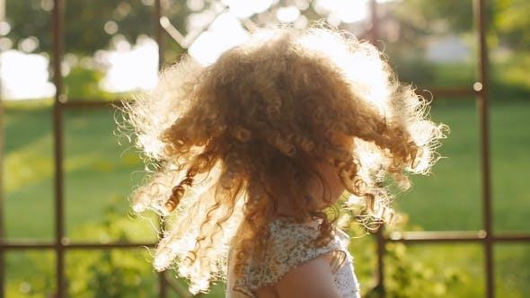 Thumbnail for The Setting Sun Plays In The Curly Hair. Portrait Of The Curly-haired Girls.