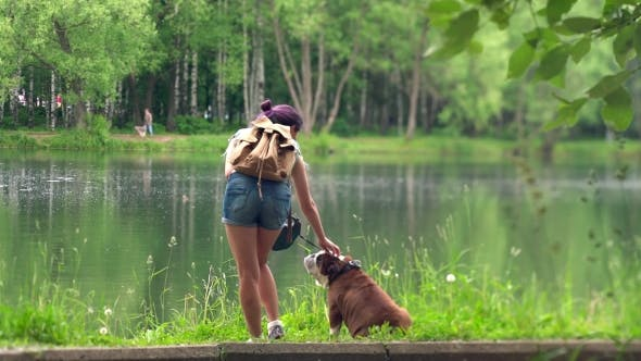 Thumbnail for Young Woman With a Bulldog By a Lake