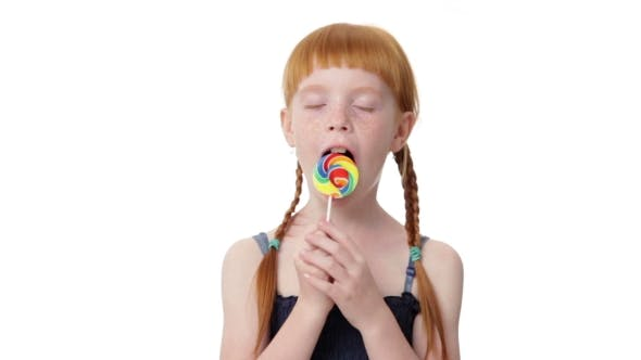 Thumbnail for Little Ginger Girl Is Licking a Lollypop