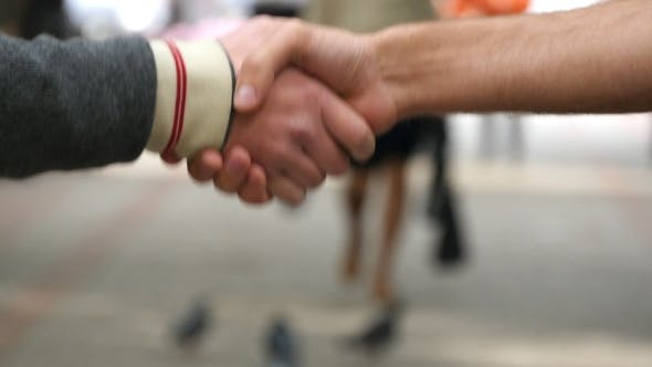 Thumbnail for Male Hands Giving The Keys To Car To His Friend. Handshake Between Two Men Outdoor.