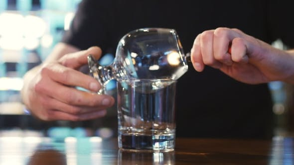 Thumbnail for Bartender Burning Sambuca At The Bar. Spectacular Cooking Sambuca At The Bar