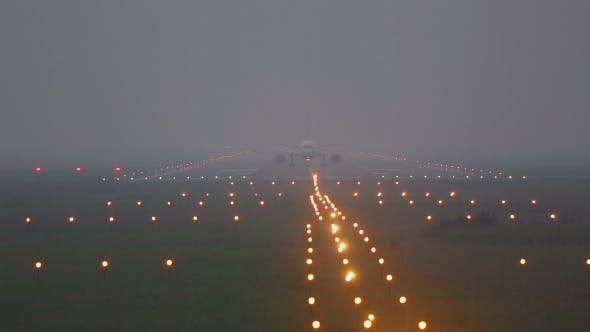Cover Image for Airplane Taxiing On Runway In Fog
