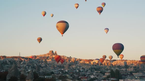Colorful Hot Balloons Fly Over City