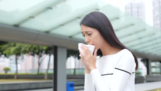 Thumbnail for Young Woman sneeze at outdoor