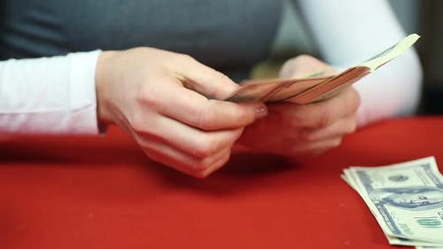 Bank Accountant Counting Money and Giving Salary to Workers