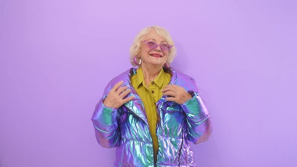 Happy Elderly Woman Happy with Herself Posing Smiling for the Camera, Isolated Background