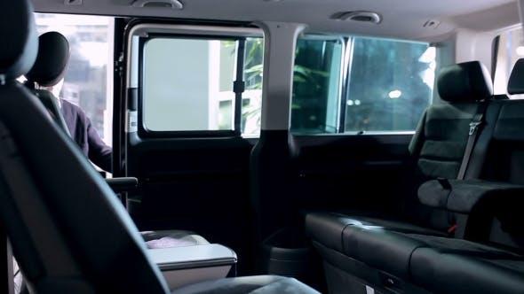 Thumbnail for Family Inspecting Itnerior Of Passenger Minibus